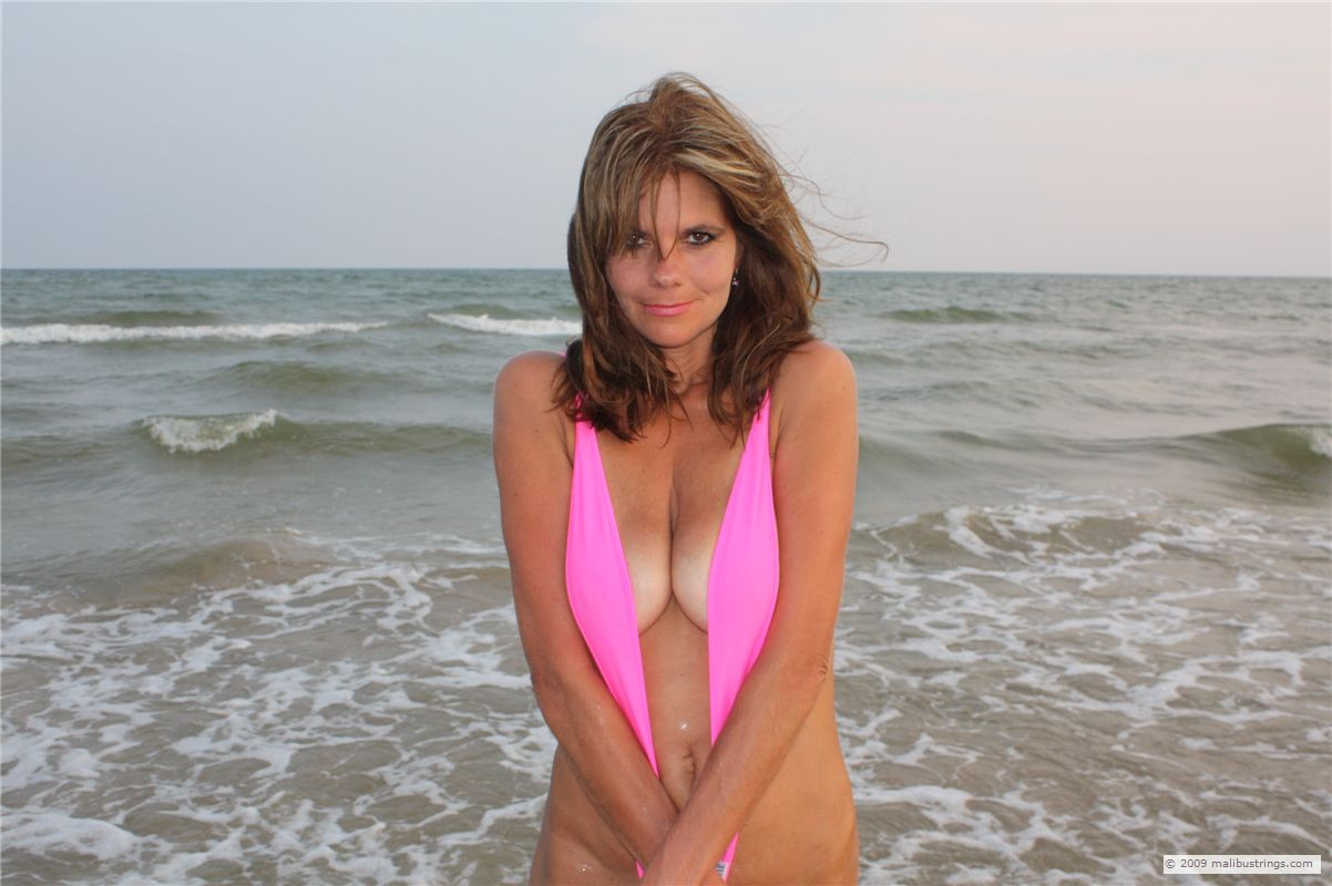 Big tit mature beach pool